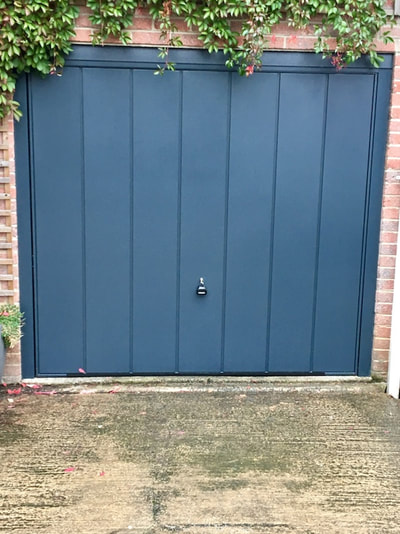 anthracite grey up and over garage door installed in Sheffield